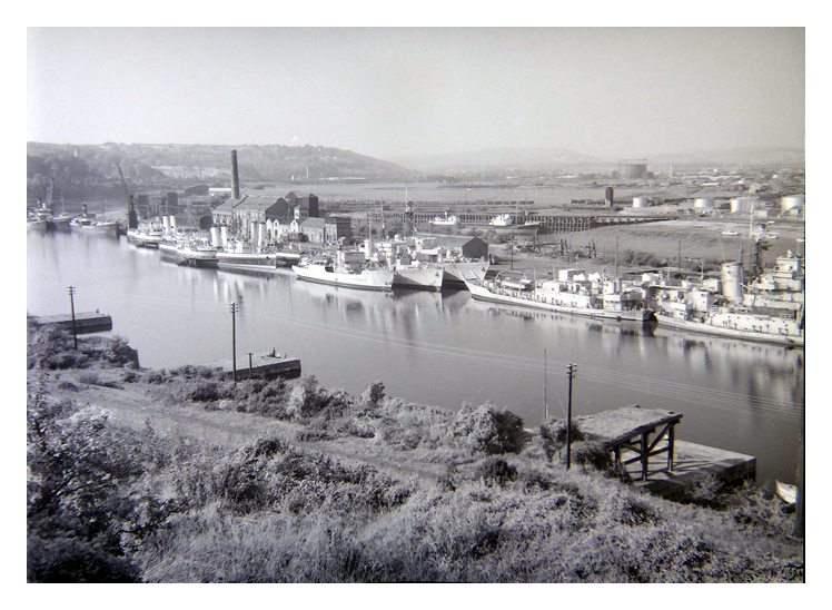 1950's - Royal Naval Reserve vessels laid up at Penarth Dock together with three White Funnel Fleet paddle steamers.
